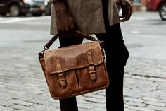 Whether for work or play, the Prince Street messenger bag delivers on both style and function. Handcrafted with our signature waxed canvas and detailed with full-grain leather, the Prince Street comfortably accommodates an 11-inch laptop or tablet, a camera, up to two lenses and small personal items. A slim removable top-grab handle and a streamlined back pocket offer additional convenience and style.