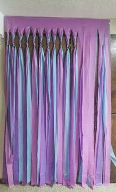 No Sew Plastic Tablecloth Streamer Ideas! - Grosgrain  Would be great to do in wedding colors for behind the wedding party at reception!