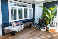 kyal and kara renovation dark blue timber panel home with white door White Deck, White Pergola, Exterior Color Schemes, Exterior House Colors, Exterior Paint, Timber Deck, Timber House, Cottage Renovation, Home Renovation