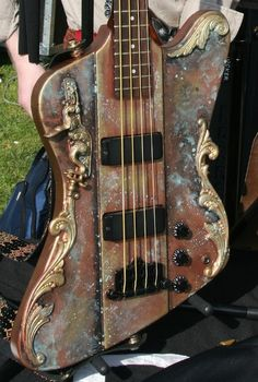 Simple homemade steampunk guitar, with the focus on selected brass accents and the busy colorization. I