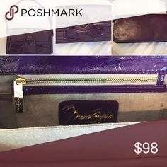 Max Azria authentic purple leather 👛 MAX AZRIA authentic purple leather clutch with detachable leather straps, this clutch 👛 is structured & small with compartments and single zipper inside. Perfect for date night! BCBGMaxAzria Bags Clutches & Wristlets