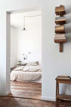 minimalist vertical wood book shelf. / sfgirlbybay
