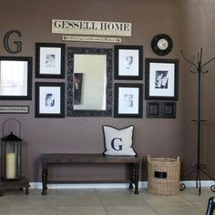 Entry way photo arrangement with letter for last name. Cute!