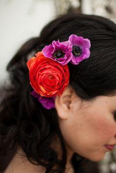bright flowers contrasting dark hair. love.