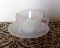 This beautiful pearlescent tea cup and saucer was manufactured by the American Company Federal Glass in the 1950s/60s. The pattern name is Moonglow. It is marked On the base with the Federal Mark (F in a shield) Heat Proof USA The milk glass typical of the era is utterly unique in