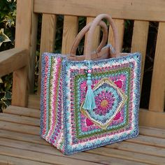 This colourful bag is based on The Jackfield Tile Square (pattern available separately - free download here) but can of course be made with any suitable square. A simple cover is constructed from three pieces, then permanently stitched to an inexpensive, ready-made canvas base - a fuss-free way of adding strength, stability, shape and handles all in one go.