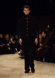 Black double-faced wool and cashmere blend military cape with pewter blue wide-leg trousers and The Sneakers