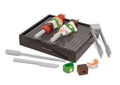 BBQ Grill set. Wooden two-piece grill features prawns, meat, onions, tomatoes, capsicum, two skewers, tongs and a wooden knife.