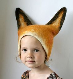 Fox Hat -- Hand Felted Wool (Etsy)  Now dont get me wrong the little girl looks like an angel but the fox hat scares me just a bit! Maybe i will wear this hat with the Fox shoes i also put in this file.