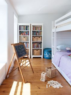 Charming kid's bedroom with bunk beds.