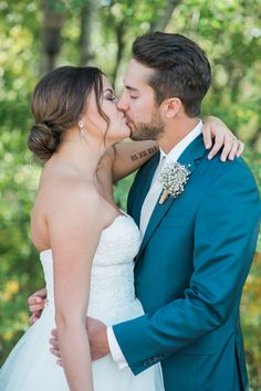 The perfect kiss! View the full wedding here: http://thedailywedding.com/2016/05/25/rustic-countryside-wedding-desurae-kyler/
