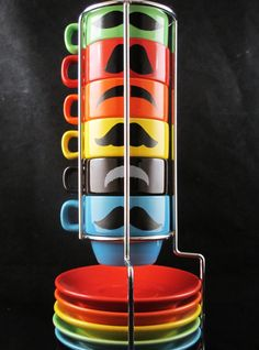Don't need it and don't have the space for it, but i really like it!  Six stackable espresso mustache mug set handpainted by kaoriglass, $35.00