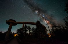 The Milky Way paints a line behind the curving arc of the Clingmans Dome observation tower.