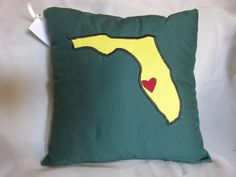 Green and gold Florida pillow with heart in Tampa.