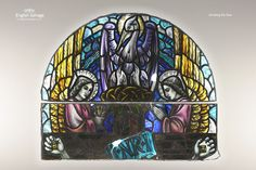 Antique Painted Stained Glass Arched Panel - Pelican in her Piety and Two Angels, above a crucifixion scene.