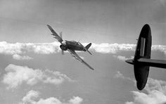 A Hawker Typhoon  approaches a Lancaster.