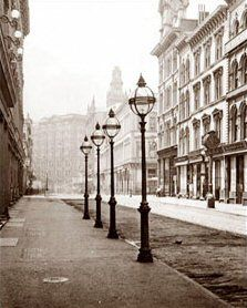 This photo shows the gas lights that lined Montgomery Street in downtown San Francisco. The view is looking towards Market St. and the Palace Hotel. 1895