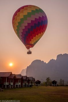Vang Vieng, Laos, Vang Vieng, Laos - A hot air balloon defends close to the bungalows on sunset in Vang Vieng Air Ballon, Hot Air Balloon, Vietnam, Oh The Places You'll Go, Places To Visit, Laos Travel, Balloon Rides, Southeast Asia, Balloons