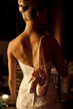 Beautiful ballerina bride carrying her ballet slippers | Aaron Watson Photography on The Lovely Find