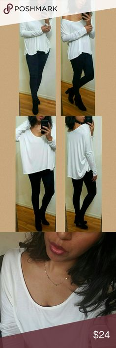 《NEW》IVORY SLUB KNIT LONG SLEEVE TOP Can't go wrong with this totally chic and comfy sub knit top. Style however you please. Dolman long sleeves. Drape it off one shoulder. Deep round neckline. Super soft material. Stretchy. Fabric Content: 96%Modal, 4% Spandex   Sizes available: S M l • Modeling size Medium •  ●•••》PRICE IS FIRM UNLESS BUNDLED 《•••● JMAY4354 Tops Tees - Long Sleeve