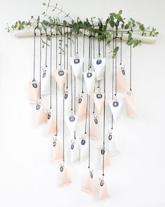 Homemade Advent Calendars For Kids. Hanging advent calendar in white and blush hung from branch. Homemade Advent Calendars, Diy Advent Calendar, Kids Calendar, Calendar Ideas, All Things Christmas, Christmas Holidays, Christmas Crafts, Christmas Decorations, Xmas