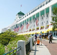 For an unforgettable experience, stay at this Victorian-era landmark with its 660-foot porch overlooking the Straits of Mackinac on Mackinac Island, Michigan. Mackinac Island Michigan, Traverse City Michigan, Michigan Travel, Lake Michigan, Frankenmuth Michigan, Wisconsin, Hills Resort, Lake Resort, Lutsen Resort