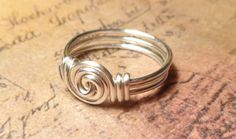 ***September SALE: Save 10% on all orders. Use coupon code 10SEPTEMBER    This swirl wire ring is dainty but sturdy. It is wrapped using your