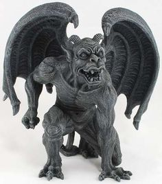 "A fierce gargoyle unfurls his wings, one fist drawn back and every muscle tensed as he prepares to strike. Made out of cold-cast resin, this 6 1/8"" tall x 6"" wide statue is a dark charcoal in color, h"