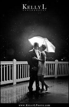black and white wedding photo in the rain