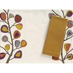 Tessa Placemat with Cotton Mustard Napkin in Placemats | Crate and Barrel