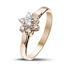 Round diamond of 0.10 Ct, of high quality Round diamonds, 6 x 0.03 Ct, of high quality (G colour, VS2 clarity, VG cut) 18 Kt red gold Measurements: Width upper part ring: 8.40 mm Width lower part...