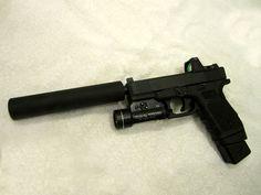 Glock 19, AAC suppressor, Trijicon RMR, Streamlight TLS, back-up suppressor sights.