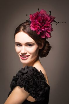 Large silk poppy flower hat/fascinator in pinks and purples with black beaded detail. Ideal for the races, weddings and special occasions.