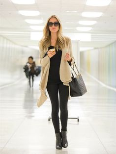 This look is comfortable for travel--as long as your boots are loose; if not, wear flats.