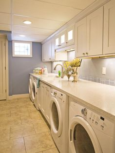 Double the Function With not just one washer and dryer but two, designer Shane Inman ensures a low turnover rate for laundry in this household. By encasing the units below a stone countertop and adding storage cabinets above, the room instantly expands its functionality and efficiency