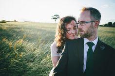 bride and groom portrait in hay field