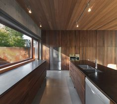 La Maison Beaumont by Henri Cleinge Architecte   Wall of window leading to door.  door directly into kitchen/living.