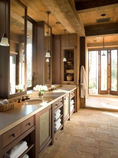 I love the cabinets, the floor, and what looks to be a very large shower at the end of the room!