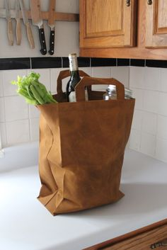 Meet the brown paper bag's more mature, older brother - the Hand-Waxed Canvas Market Bag! Made from heavy duty 100% cotton canvas that was waxed by hand. Water resistant so this bag will do its duty r