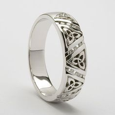 The Aillis, which is the Irish version of the name Alice, is an elegant version of the ever popular Trinity knot design fashioned in all white gold and enhanced by separating the Trinity knots with rows of glistening diamonds - See more at: http://www.celtic-weddingrings.com/Celtic-Wedding-Rings/Ailis-Trinity-Wedding-Ring-P767.html#sthash.5s2uwf2G.dpuf