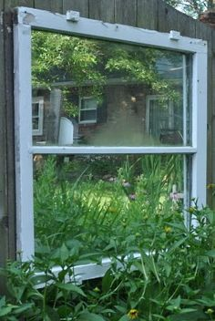 Put a mirror behind an old window and it seems you have cut a hole in your fence