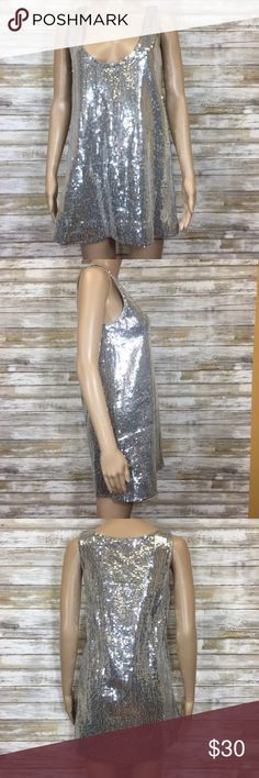 """Free People Silver Metallic Sequin Tunic Dress You absolutely need this dress for the upcoming holidays! It will have you humming silver bells with the greatest holiday cheer!  Brand: Free People  Size: 2 Condition: missing a couple sequins  100% Cotton Care instructions: turn inside out, hand wash cold, line dry  Measurements (flat): Armpit to armpit: 17"""" Waist: 17.5"""" Bottom hem: 21"""" Length: 20"""" Free People Dresses"""