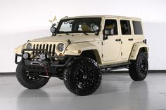 Dallas' Starwood Custom's: 2012 Jeep Wrangler Unlimited sport with Matte Sahara tan Kevlar Liner