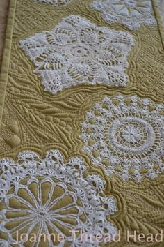 Falling flakes  The Falling Snowflakes quilt is a project that incorporates lace doilies with cotton and metallic threads for a beautiful sampler of free-motion quilting designs.