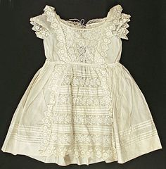 http://www.metmuseum.org/Collections/search-the-collections/80030250?rpp=60=2=*=Dresses|Linen=79  All over lace.  Lovely tucks.
