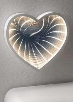 This infinity mirror is a unique piece to add a warm glow into the bedroom. In a delightful heart shape, the mirror houses LED lights to produce a space...