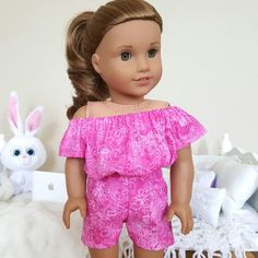 18 inch doll pink romper with butterfly and floral print.