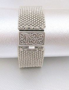 A silver beaded bracelet that is edgy and chic. A peyote bracelet made of silver seed beads with a beautiful box clasp . For the rock chick, goth chick or any chick that likes an edge of uniqueness in their jewelry selection. This can be worn with just about anything. 1 1/2 wide, fits a 7 1/2 wrsit. Silver box clasp. Treat yourself