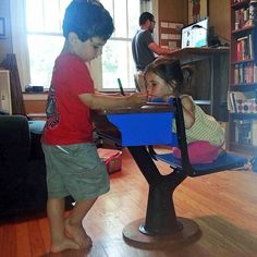 A family of standing desk users at home. (Courtesy of Sandor Weisz)