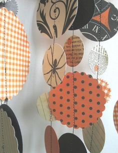 DIY Halloween garland.  Pick patterned paper or fabric & send it through the sewing machine to connect. by ophelia